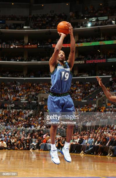 Sam Cassell of the Minnesota Timberwolves shoots against the Los Angeles Lakers defense in Game three of the Western Conference Finals during the...