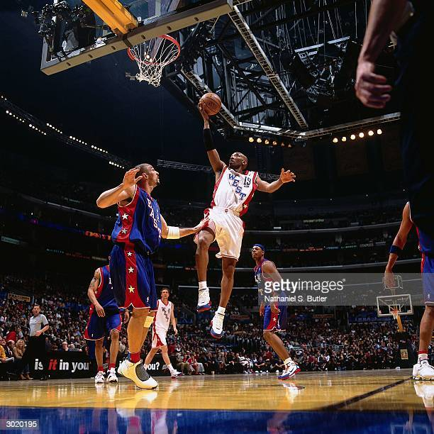 Sam Cassell of the Western Conference AllStars shoots against Jason Kidd of the Eastern Conference AllStars during the 2004 AllStar Game on February...