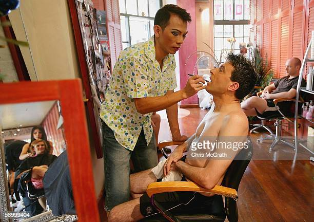 Sam Chalotorn does makeup for partner Brad Merriel prior to the start of the 2006 Sydney New Gay and Lesbian Mardi Gras parade March 4 2006 in Sydney...
