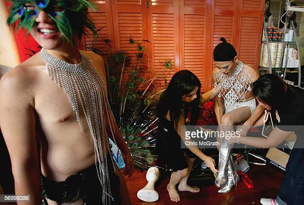 Sam Chalotorn is helped by friends as he gets dressed into his Mardi Gras costume at a Sydney hair salon prior to the start of the 2006 Sydney New...