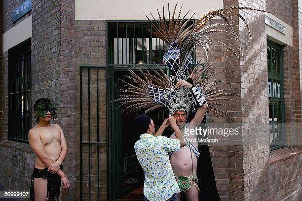 Sam Chalotorn makes final adjustments to partner Brad Merriel's costume outside a Sydney hair salon prior to the start of the 2006 Sydney New Gay and...