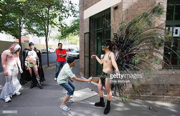 Sam Chalotorn sprays glitter over a friends costume outside a Sydney hair salon prior to the start of the 2006 Sydney New Gay and Lesbian Mardi Gras...