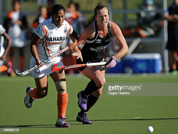 Sam Charlton of New Zealand and Deepika of India compete for a loose ball during the match between New Zealand and India at the National Hockey...