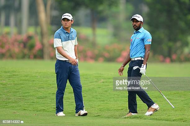 Sam Chien of USA and Chikkarangappa S of India pictured during round one of the BANK BRIJCB Indonesia Open at Pondok Indah Golf Course on November 17...