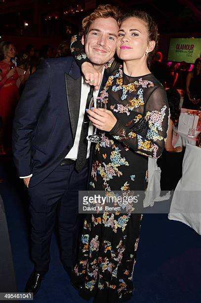 Sam Claflin and Hayley Atwell attend the Glamour Women of the Year Awards after party in Berkeley Square Gardens on June 3 2014 in London England