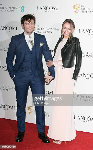 Sam Claflin and Laura Haddock attend the Lancome BAFTA nominees party at Kensington Palace on February 13 2016 in London England