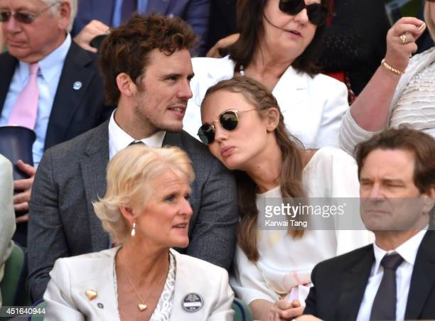 Sam Claflin and Laura Haddock attend the quarter final match beteween Lucie Safarova v Petra Kvitova on centre court during day ten of the Wimbledon...