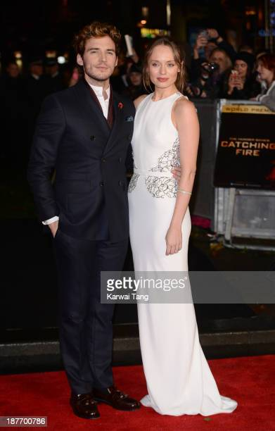 Sam Claflin and Laura Haddock attend the UK Premiere of 'The Hunger Games Catching Fire' at Odeon Leicester Square on November 11 2013 in London...