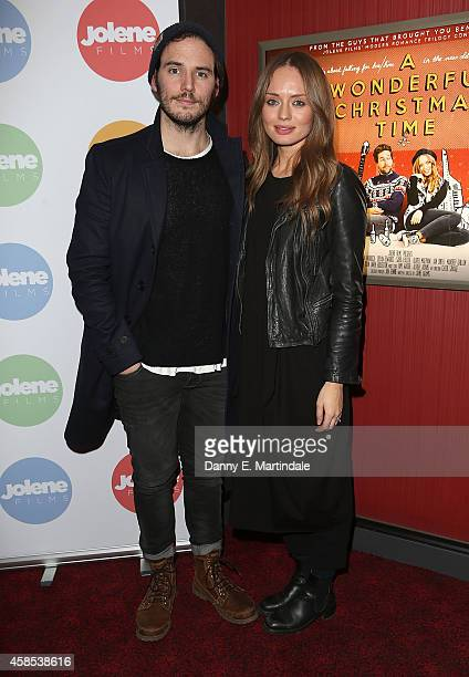 Sam Claflin and Laura Haddock attends the UK Premiere of 'A Wonderful Christmas Time' at Empire Leicester Square on November 6 2014 in London England