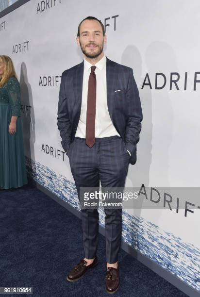 Sam Claflin arrives at the premiere of STX Films' Adrift at Regal LA Live Stadium 14 on May 23 2018 in Los Angeles California