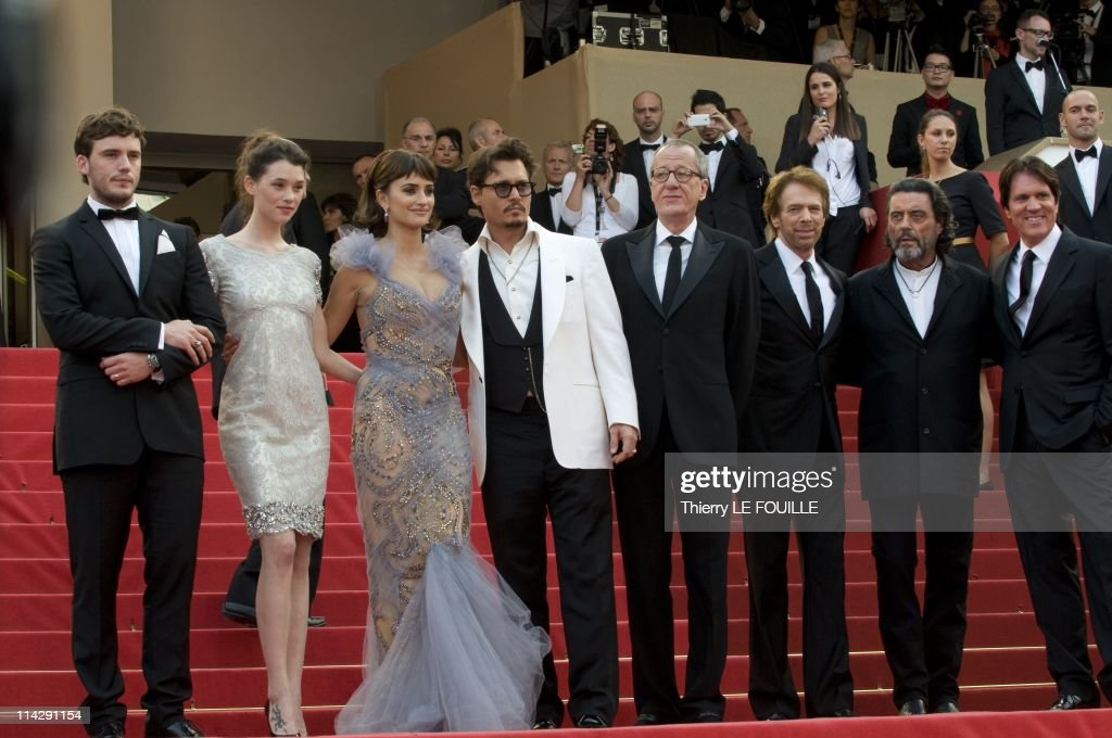 Sam Claflin, Astrid Berges-Frisbey, Penelope Cruz, Johnny Depp, Geoffrey Rush, Producer Jerry Bruckheimer, Ian Mcshane and Director Rob Marshall arrive at the 'Pirates of the Caribbean: On Stranger Tides' premiere during the 64th Annual Cannes Film Festival at the Palais des Festivals on May 14, 2011 in Cannes, France.