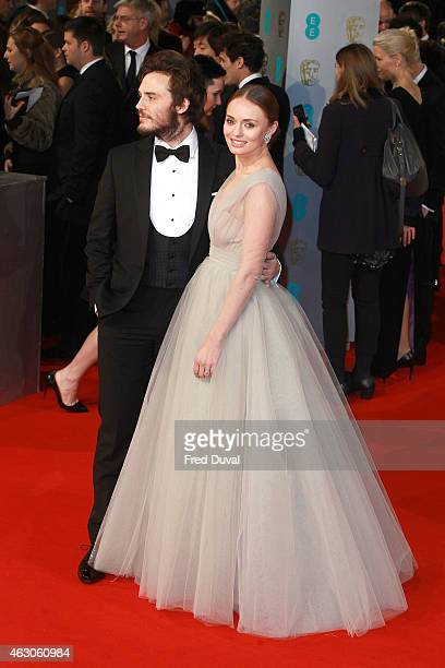 Sam Claflin Laura Haddock attend the EE British Academy Film Awards at The Royal Opera House on February 8 2015 in London England