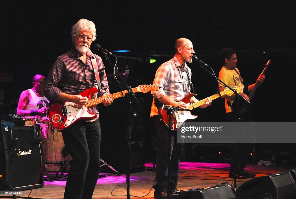 Sam Clayton, Fred Tackett, Paul Barrere and Kenny Gradney of Little Feat perform on stage at Norwich UEA LCR on February 10, 2013 in Norwich, England.