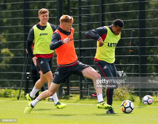 Sam Clucas against Matrin Olsson during the Swansea City Training and Press Conference at The Fairwood Training Ground on August 24 2017 in Swansea...