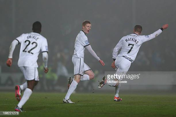 Sam Clucas of Hereford United celebrates scoring the equalising goal with Marley Watkins during the FA Cup with Budweiser Second Round Replay match...