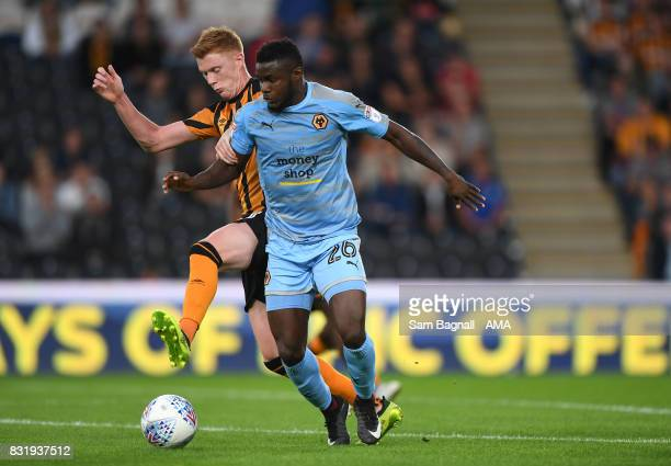 Sam Clucas of Hull City and Bright Enobakhare of Wolverhampton Wanderers during the Sky Bet Championship match between Hull City and Wolverhampton at...