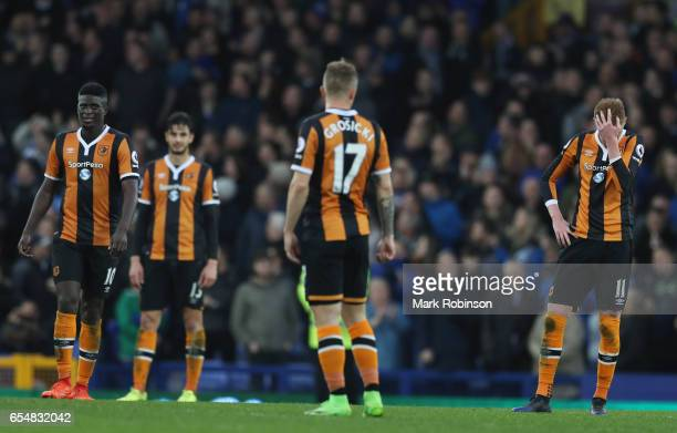 Sam Clucas of Hull City and team mates look dejected in defeat after the Premier League match between Everton and Hull City at Goodison Park on March...