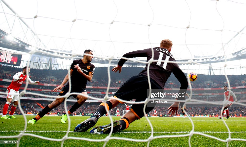 Sam Clucas (C) of Hull City clears the header by Lucas Perez (1st L) of Arsenal with his arm resulting in a penalty kick to Arsenal during the Premier League match between Arsenal and Hull City at Emirates Stadium on February 11, 2017 in London, England.