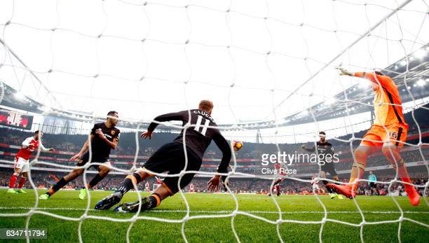 Sam Clucas of Hull City clears the header by Lucas Perez of Arsenal with his arm resulting in a penalty kick to Arsenal during the Premier League...