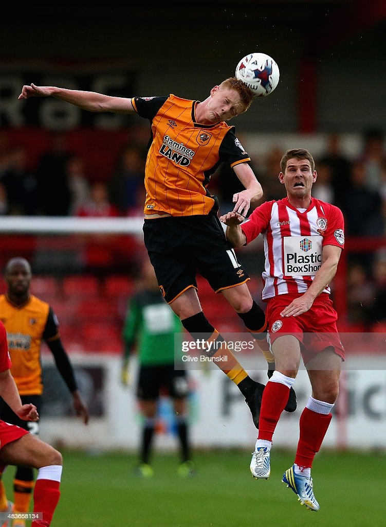 Sam Clucas of Hull City in action with Anthony Barry of Accrington Stanley during the Capital One Cup First Round match between Accrington Stanley and Hull City at Wham Stadium on August 11, 2015 in Accrington, England.