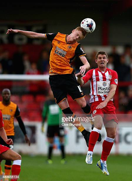 Sam Clucas of Hull City in action with Anthony Barry of Accrington Stanley during the Capital One Cup First Round match between Accrington Stanley...