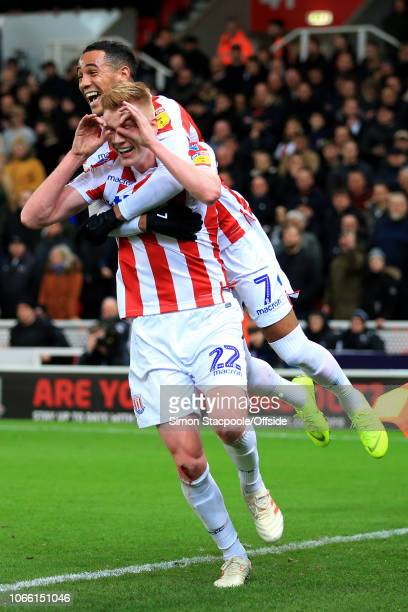 Sam Clucas of Stoke celebrates with teammate Thomas Ince of Stoke on his back after scoring their 1st goal during the Sky Bet Championship match...