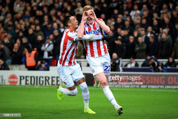 Sam Clucas of Stoke celebrates with teammate Thomas Ince of Stoke after scoring their 1st goal during the Sky Bet Championship match between Stoke...