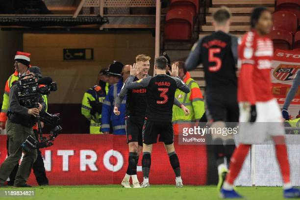 Sam Clucas of Stoke City celebrates with Stephen Ward after scoring their first goal during the Sky Bet Championship match between Middlesbrough and...