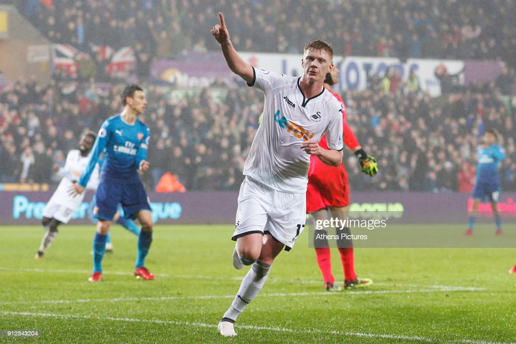 Sam Clucas of Swansea celebrates scoring his sides first goal of the match to equalise during the Premier League match between Swansea City and Arsenal at the Liberty Stadium on January 30, 2018 in Swansea, Wales.
