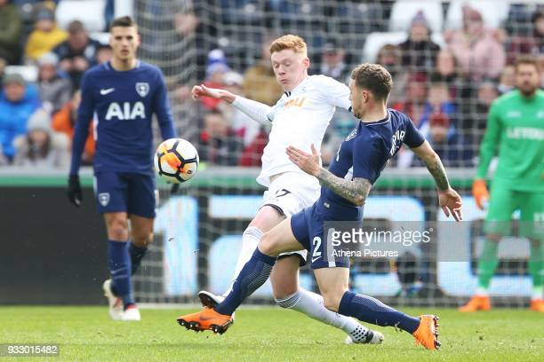 Sam Clucas of Swansea challenges Kieran Trippier of Tottenham Hotspur during the Fly Emirates FA Cup Quarter Final match between Swansea City and...