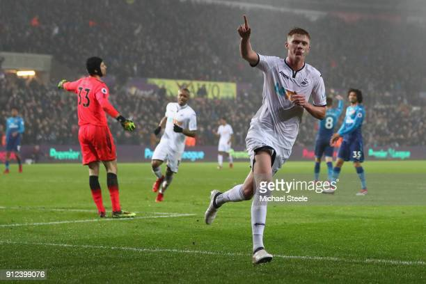 Sam Clucas of Swansea City celebrates after scoring his sides first goal during the Premier League match between Swansea City and Arsenal at Liberty...