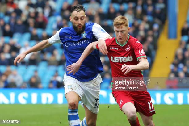Sam Clucas of Swansea City closely followed by Atdhe Nuhiu of Sheffield Wednesday during The Emirates FA Cup Fifth Round match between Sheffield...