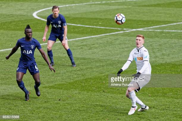 Sam Clucas of Swansea City controls the ball close to Davinson Sanchez and Jan Vertonghen of Tottenham Hotspur during the Emirates FA Cup Quarter...
