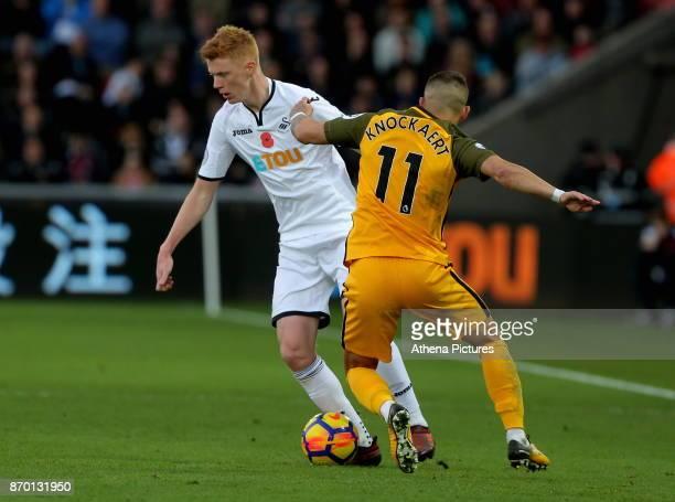 Sam Clucas of Swansea City moves to avoid Anthony Knockaert of Brighton during the Premier League match between Swansea City and Brighton and Hove...
