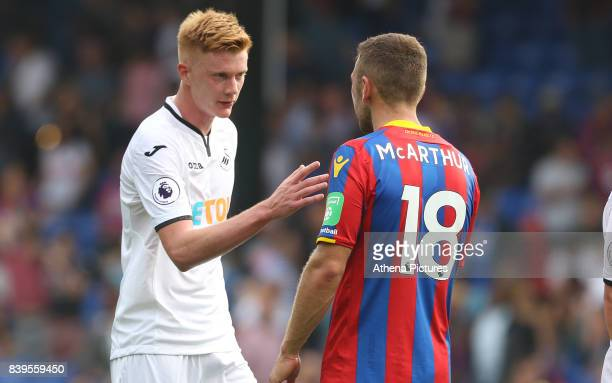 Sam Clucas of Swansea City shakes hands with James McArthur of Crystal Palace after the final whistle of the Premier League match between Crystal...