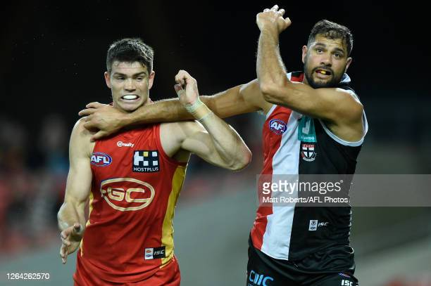 Sam Collins of Gold Coast Suns competes for the ball against Paddy Ryder of the Saints during the round 10 AFL match between the Gold Coast Suns and...