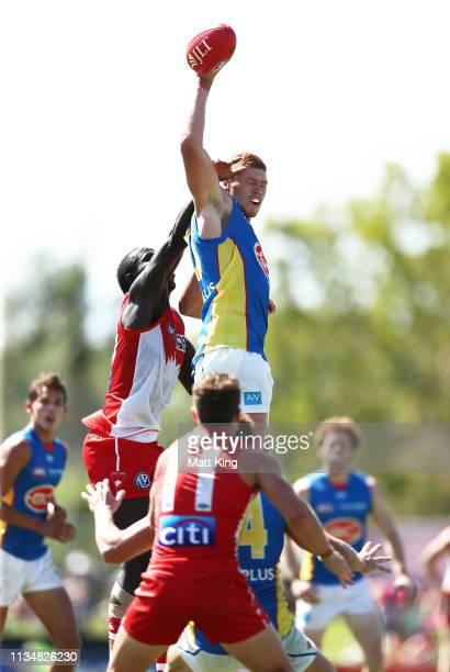 Sam Collins of the Suns taps the ball down during the 2019 JLT Community Series AFL match between the Sydney Swans and the Gold Coast Suns at Oakes...