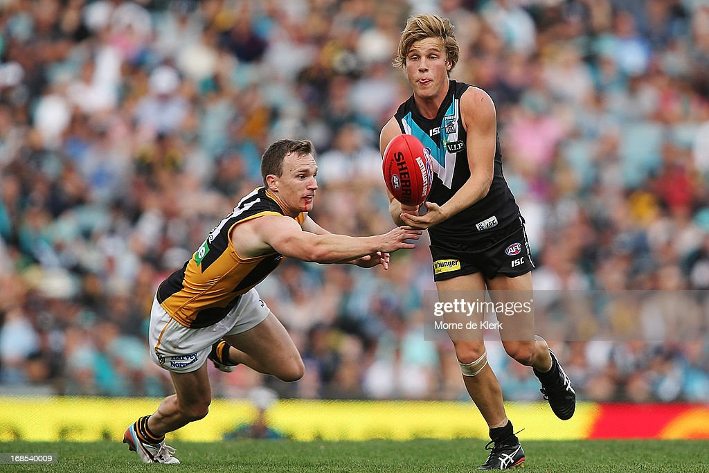Sam Colquhoun of the Power passes the ball during the round seven AFL match between Port Adelaide Power and the Richmond Tigers at AAMI Stadium on May 11, 2013 in Adelaide, Australia.