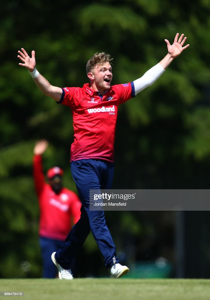 Sam Cook of Essex celebrates dismissing Hilton Cartwright of Middlesex during the Royal London One-Day Cup match between Middlesex and Essex at Radlett Cricket Club on May 17, 2018 in Radlett, England.
