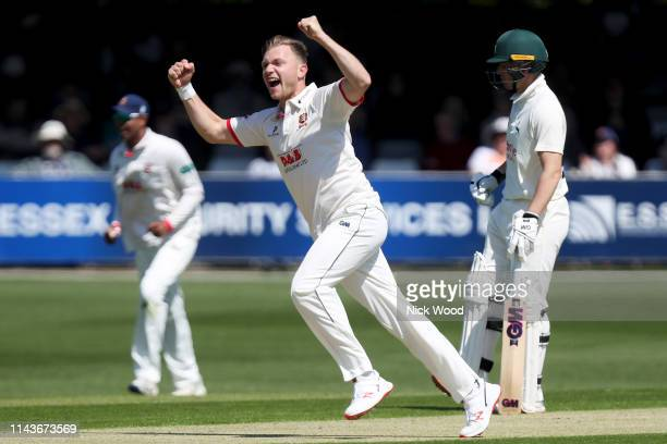 Sam Cook of Essex celebrates taking the wicket of Chris Nash during the Specsavers County Championship Division One match between Essex and...