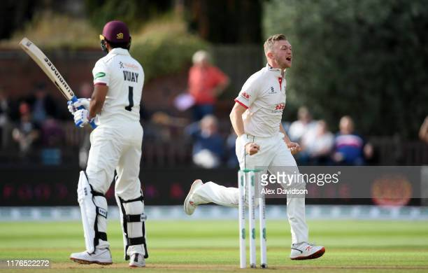Sam Cook of Essex celebrates the wicket of Murali Vijay of Somerset during Day One of the Specsavers County Championship Division One match between...