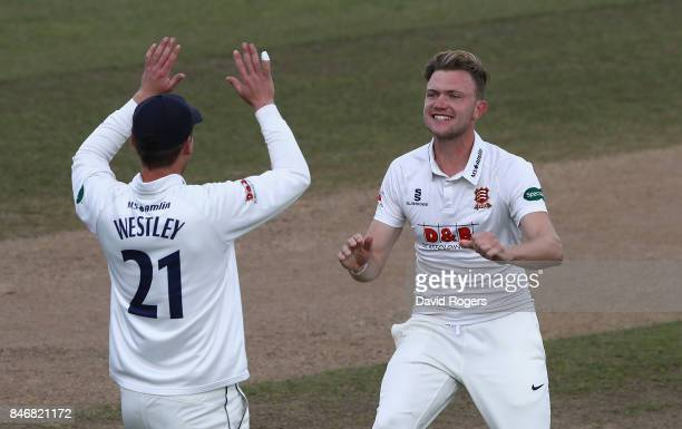 Sam Cook of Essex celebrates with team mate Tom Westley after taking the wicket of Ian Bell during the Specsavers County Championship Division One...
