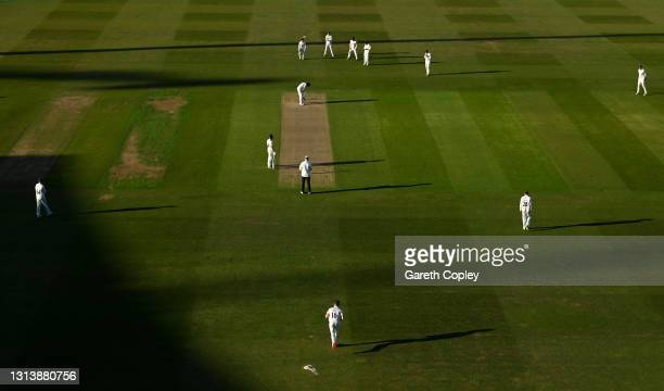 Sam Cook of Essex runs into bowl during the LV= Insurance County Championship match between Warwickshire and Essex at Edgbaston on April 22, 2021 in...