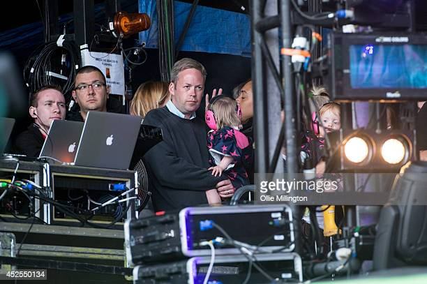 Sam Cooper Marnie Rose Cooper and Ethel Mary watch on as Lilly Allen performs on the main stage during Day 1 of the Glastonbury Festival at Worthy...