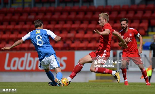 Sam Cosgrove of Aberdeen challenges Murray Davidson of St Johnstone in the first half during the PreSeason Friendly between St Johnstone and Aberdeen...
