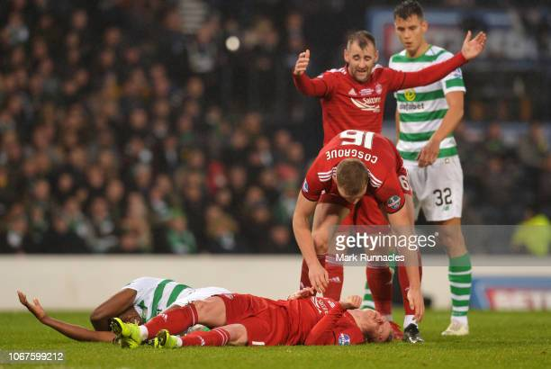Sam Cosgrove of Aberdeen stands over injured team mate Gary MackaySteven of Aberdeen as he clashes heads with Dedryck Boyata of Celtic during the...