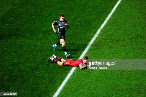 Sam Costelow of Scarlets scores his side's second try during the Guinness Pro14 match between the Scarlets and Dragons at the Parc y Scarlets on...