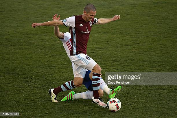 Sam Cronin of Colorado Rapids controls the ball and is contested by Will Johnson of Toronto FC at Dick's Sporting Goods Park on April 2 2016 in...