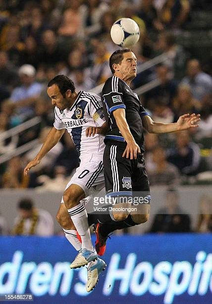 Sam Cronin of the San Jose Earthquakes and Landon Donovan of the Los Angeles Galaxy vie for the high ball in the first half during the first leg of...