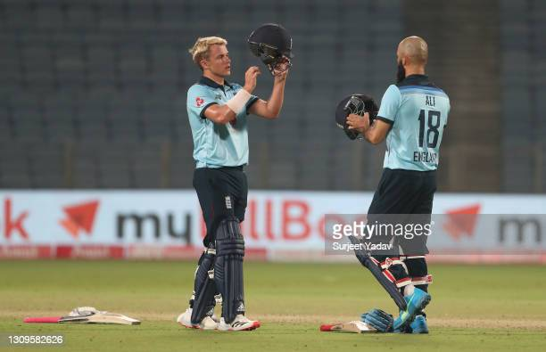Sam Curran and Moeen Ali of England look on during a drinks break during the 3rd One Day International match between India and England at MCA Stadium...